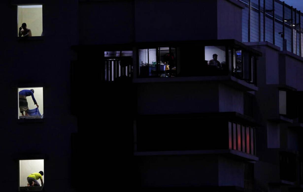 Migrant workers pray in their dormitory during the holy month of Ramadan, amid the coronavirus disease (COVID-19) outbreak, in Singapore May 8, 2020. Picture taken May 8, 2020.