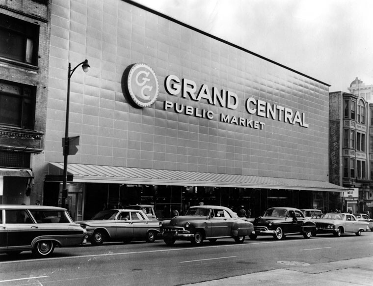 New facade for the 45-year old Grand Central Public Market features 120 ft. long, 3-story high facade, constructed with a porcelain enamel field of blue over columns of granite with stainless steel entrance gates. | Courtesy of Herald-Examiner Collection