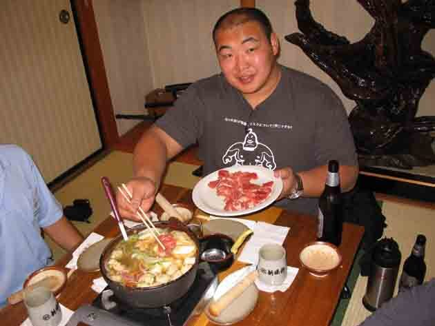 Byamba, enjoying chano-nabe, or sumo stew, at an L.A. restaurant. Photo courtesy USA SUMO
