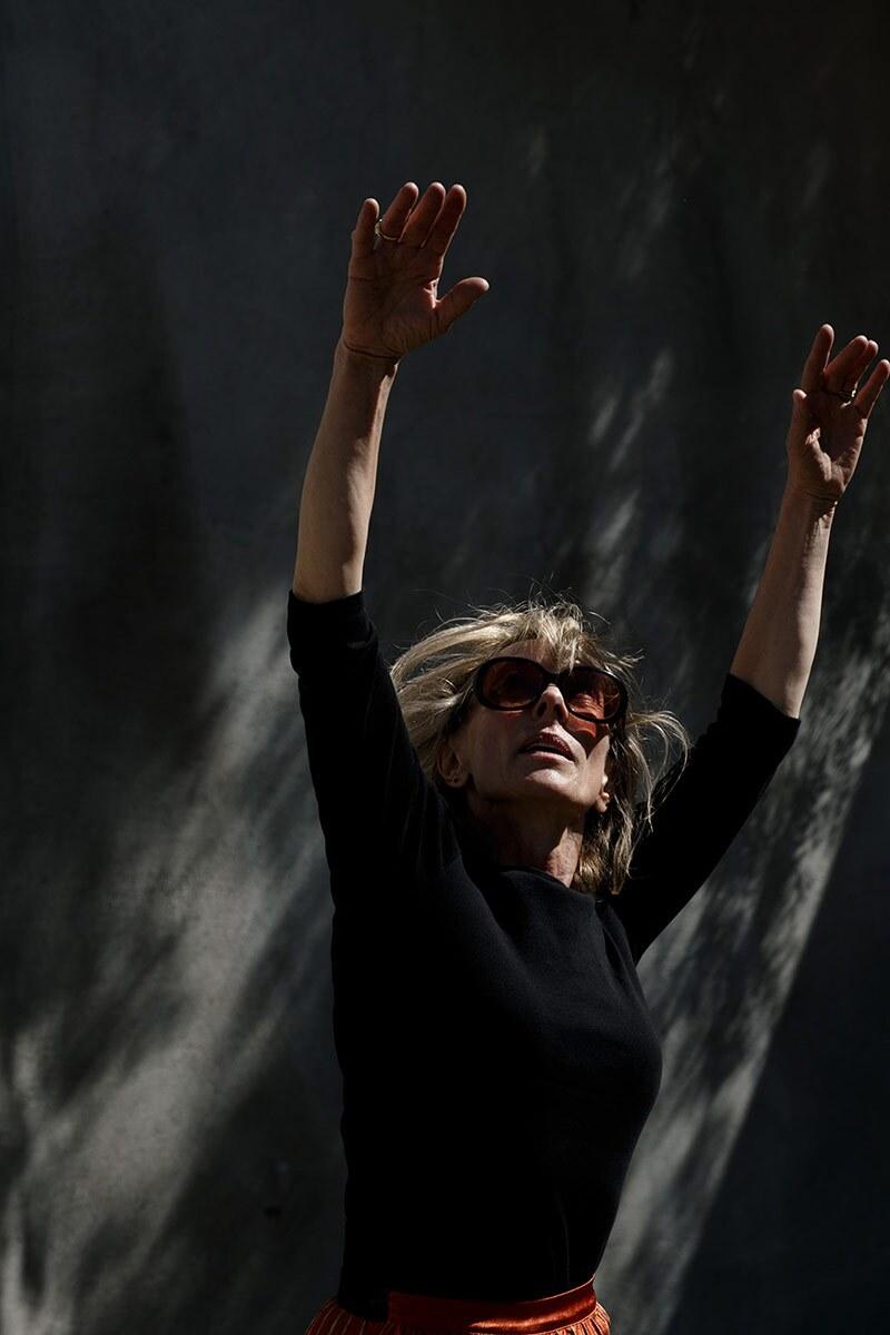 Heidi Duckler stretches her hands towards the sky.   Courtesy of Heidi Duckler