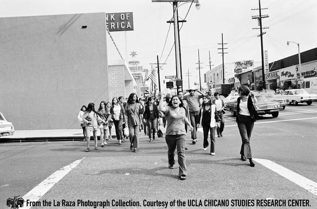 CSRC_LaRaza_B2F5C1_Staff_014 Protesters cross the street at Lincoln High School strike |  La Raza photograph collection. Courtesy of UCLA Chicano Studies Research Center
