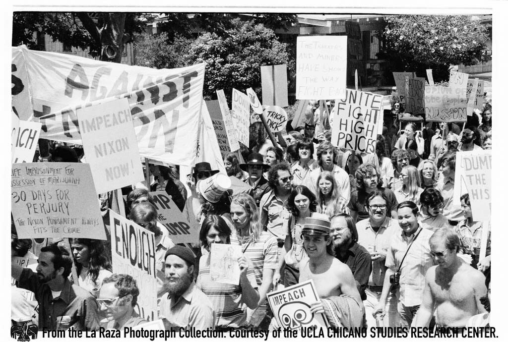 """CSRC_LaRaza_B15F14C1_Staff_003 Protesters demonstrate against President Richard Nixon in the """"Dump Nixon"""" march from Echo Park to MacArthur Park 
