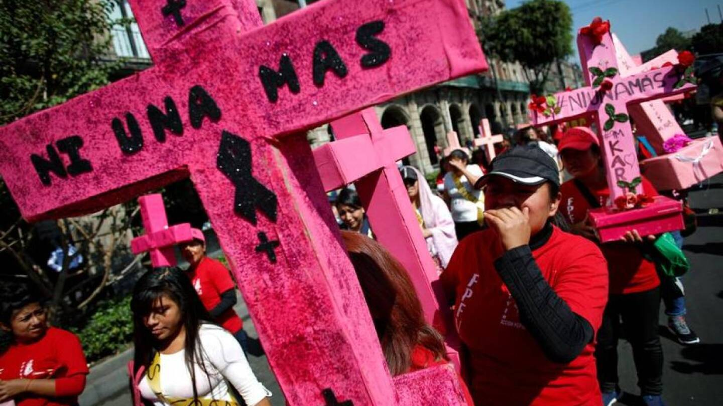 "Women carry pink crosses during the ""Day without women"" protest, as part of the escalation of historic protests against gender violence, in Mexico City, Mexico, March 9, 2020. 