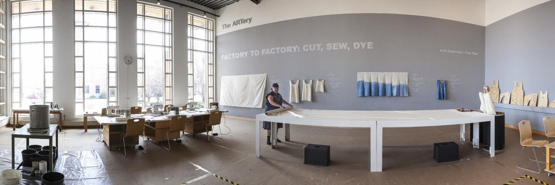 "Frau Fiber preparing for production at ""Factory to Factory: Cut and Sew""   John Michael Kohler Arts Center, Sheboygan WI 2015"