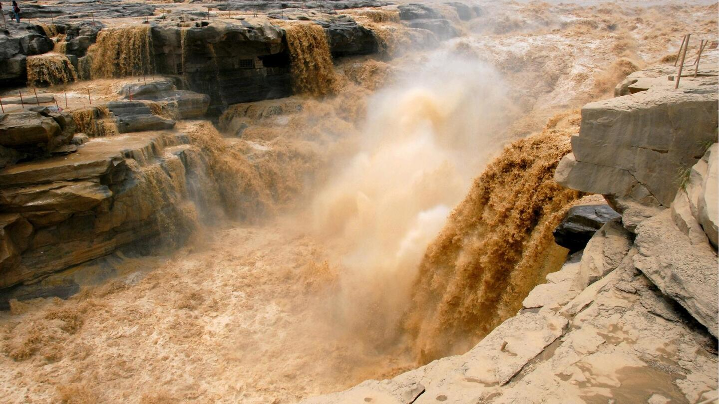 """Gushing waters flood through a canyon. 