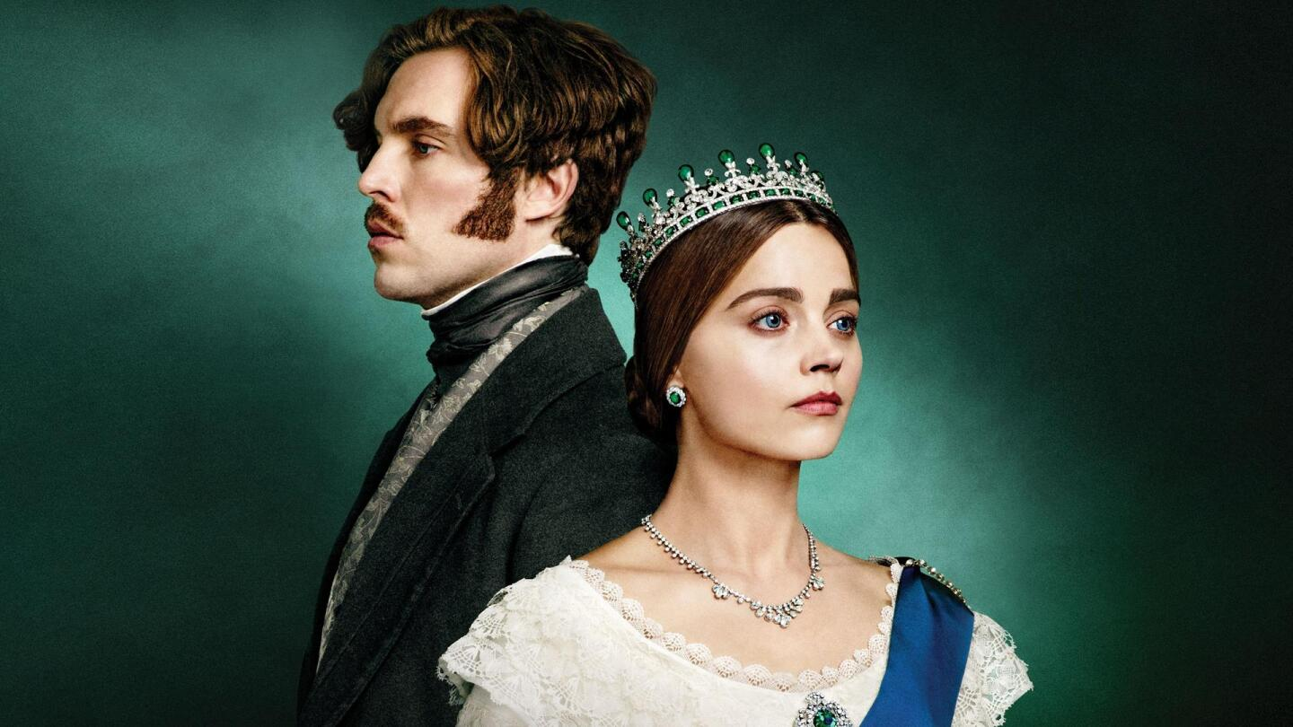 """Queen Victoria (Jenna Coleman) and Prince Albert (Tom Hughes) face opposite directions. 