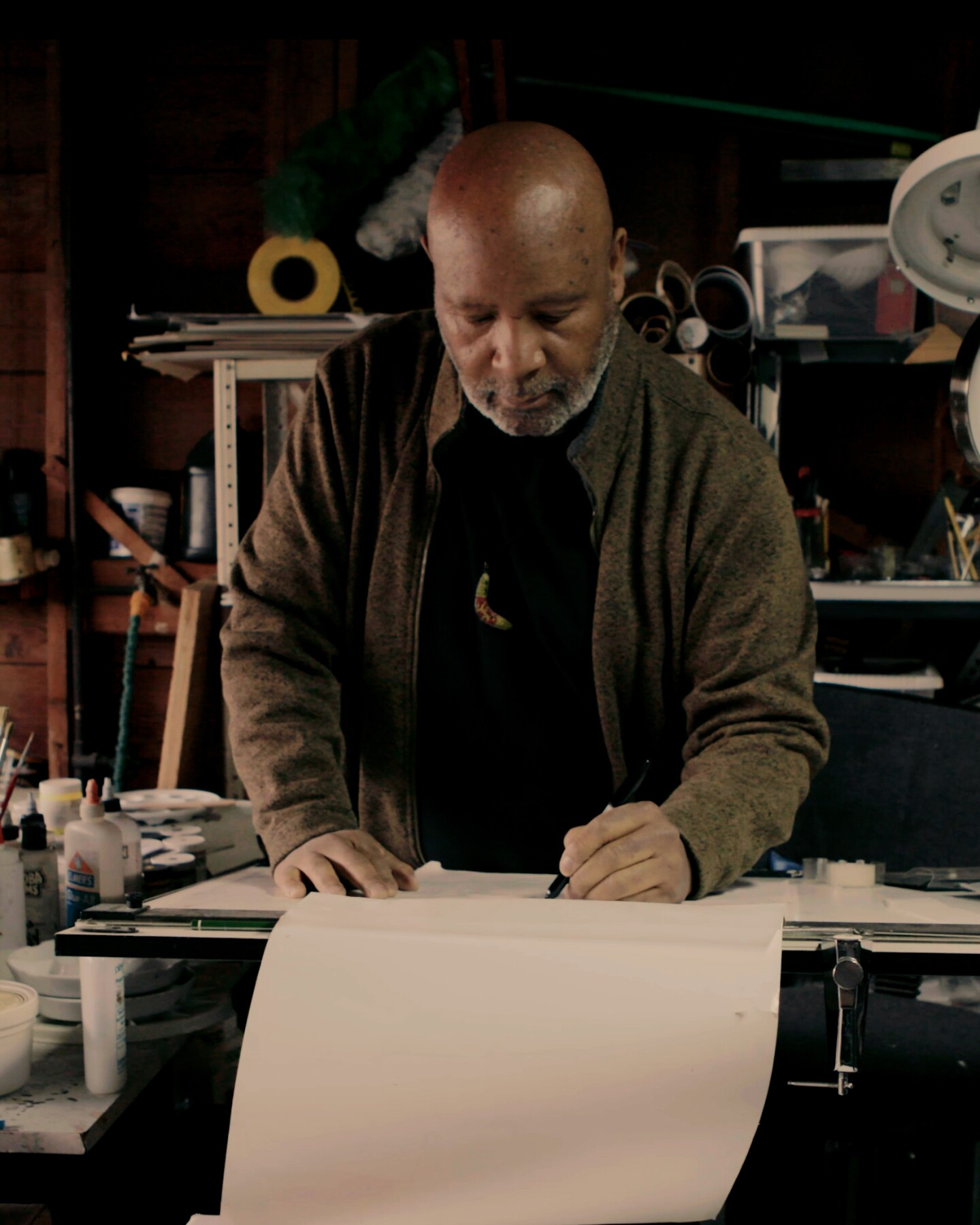 Graphic design Emory Douglas working in his studio.