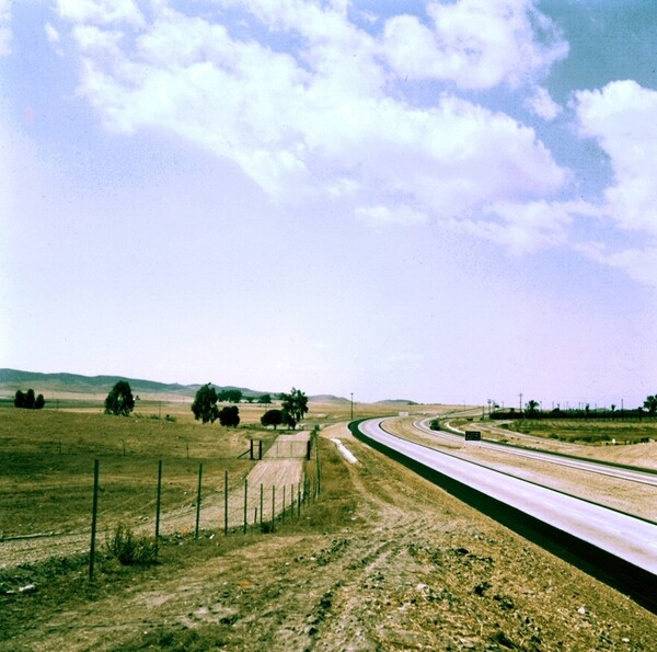 The I-5 freeway, pictured here in the 1960s at El Toro Road as a four-lane highway, becomes a 26-lane superfreeway at the El Toro Y interchange. Photo courtesy of the Orange County Archives.