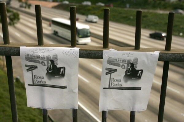 Photos of Rosa Parks hang at a highway overpass in Los Angeles named for the American civil rights icon after a tribute by black community leaders on October 25, 2005.   Photo: ROBYN BECK/AFP/Getty Images