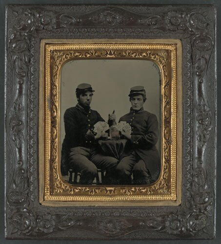 Two unidentified soldiers in Union uniforms drinking whiskey and playing cards | Library of Congress