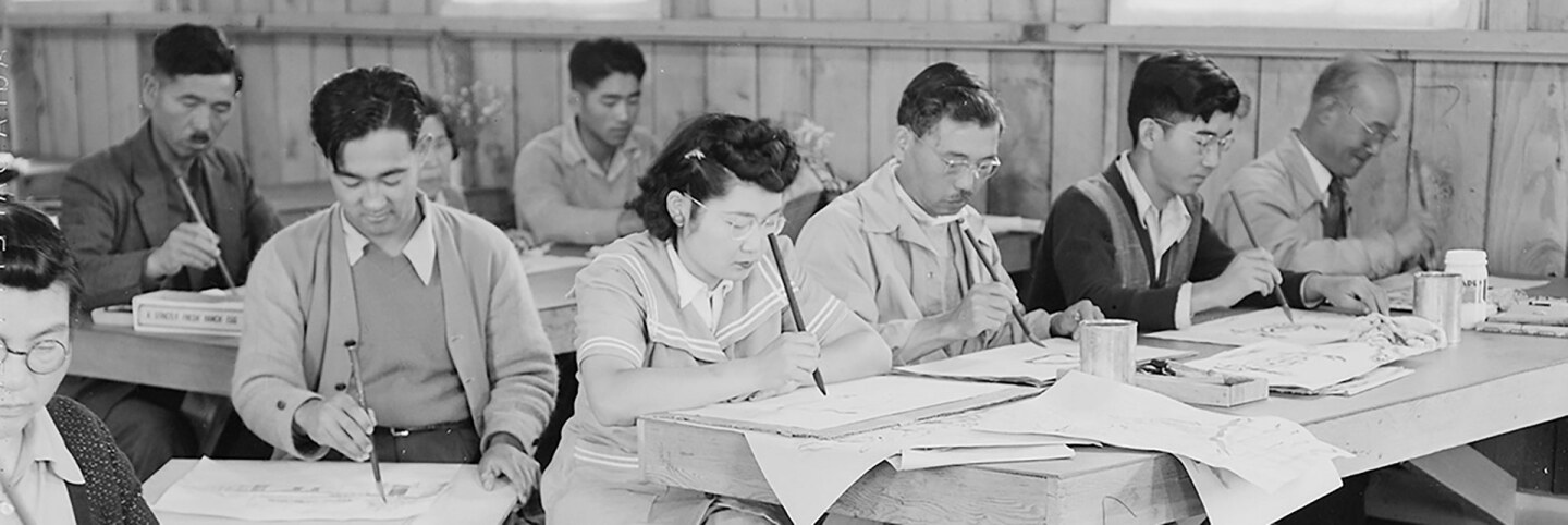 Adult art classes learning freehand brush strokes. | Dorothea Lange, War Relocation Authority Photographs of Japanese-American Evacuation and Resettlement / National Archives