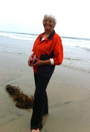 Olga Connolly, at the beach with a discus, 2012. Photo courtesy Olga Connolly
