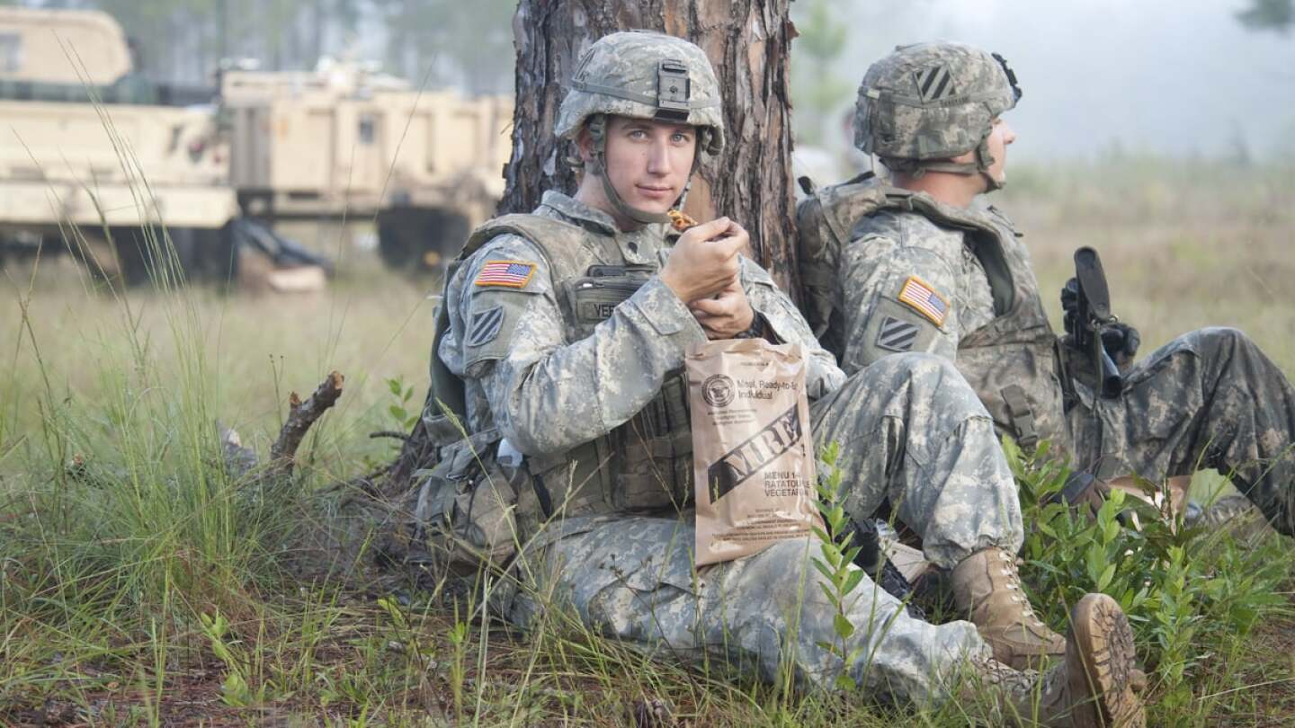 A still of soldier eating a Meals Ready to Eat (MRE) ration