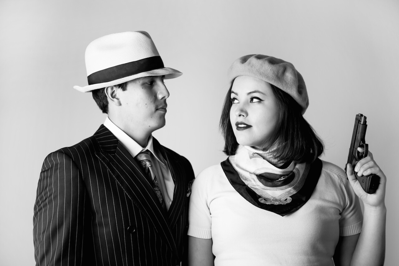 """Brian Vallie (Crow) and JaNae Collins (Dakota) channel Warren Beatty and Faye Dunaway as Bonnie and Clyde, in the photo series """"Real NDNZ Re-take Hollywood"""" by Pamela J. Peters."""