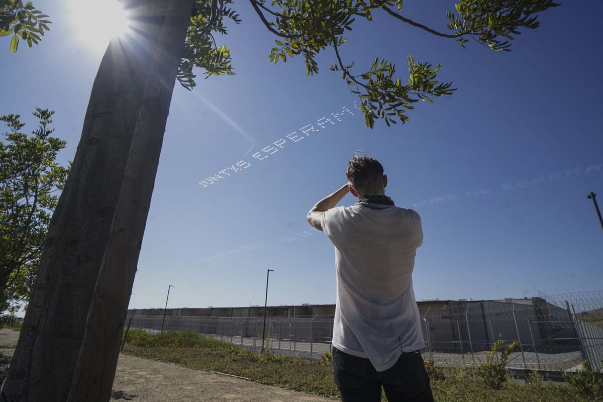 """""""JUNTXS ESPERAMOS, NO SON OLVIDADOS"""" written in in the sky, contributed by Alberto Louie, Guadalupe Rosales and ACLU SoCal over Otay Mesa Detention Center 