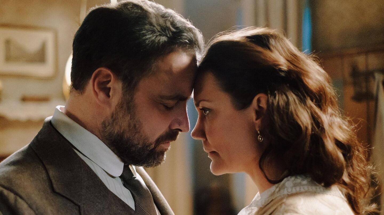 "Oskar Rheinhardt presses his forehead against a woman's. | From ""Vienna Blood: Episode Six"""