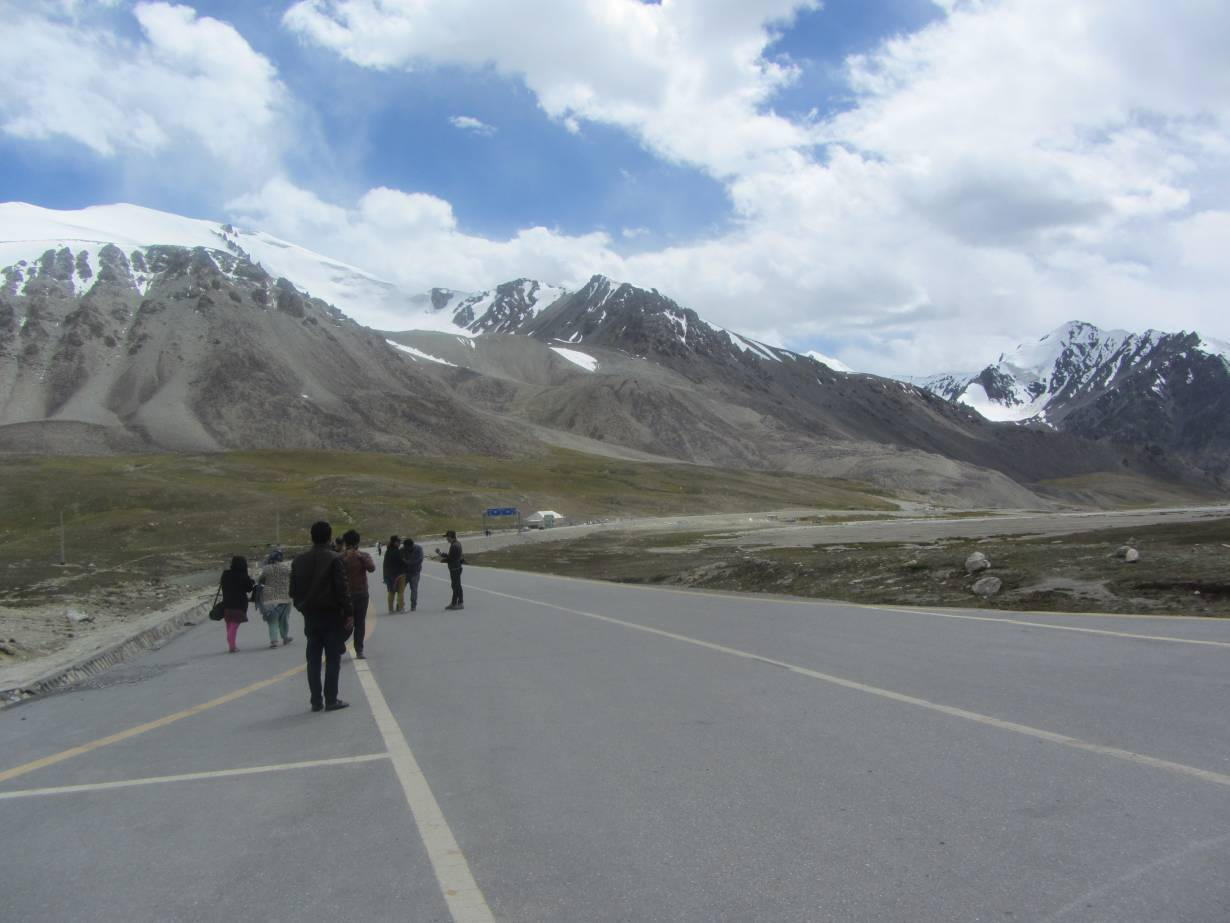 ARCHIVE PHOTO: Visitors look at the mountains of Khunjerab National Park in Pakistan, August 19, 2017. | Thomson Reuters Foundation/Rina Saeed Khan