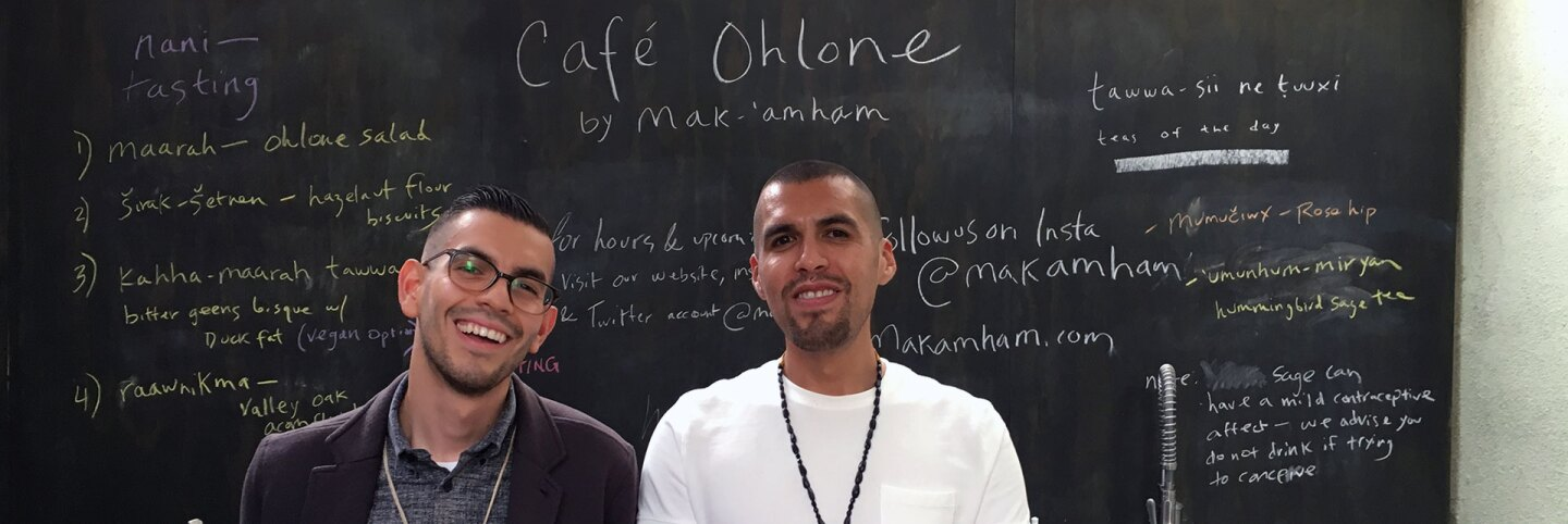 Louis Trevino (left) and Vincent Medina (right) stand in front of their Café Ohlone chalkboard menu. | Momo Chang