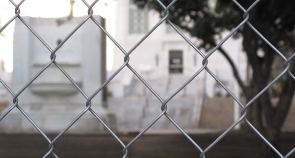 Looking through the gate at the former site of Occupy L.A. | Photo by Jason Rosencrantz