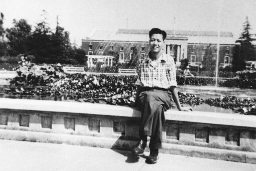 A Chinese American man sits at Exposition Park
