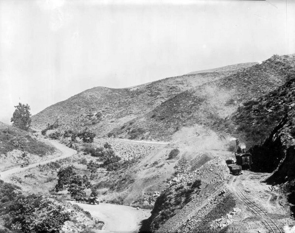 Construction of the Pacific Electric's San Fernando Valley line brought rails and overhead wires to Cahuenga Pass in 1911. Courtesy of the USC Libraries - California Historical Society Collection.