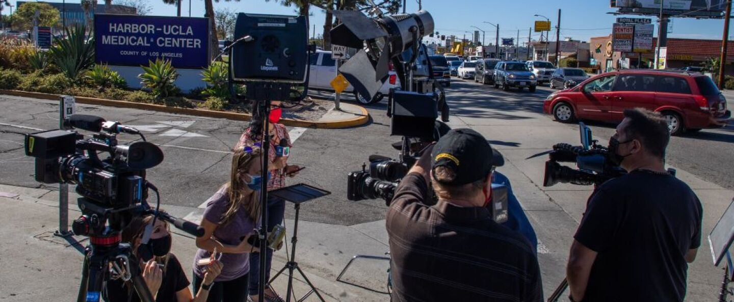 Media reporters gather by the main entrance of the Harbor UCLA Medical Center in Torrance, California on February 23, 2021.