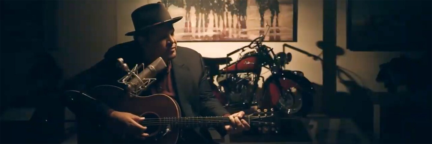 """Chris Pierce plays his guitar at The Autry. 