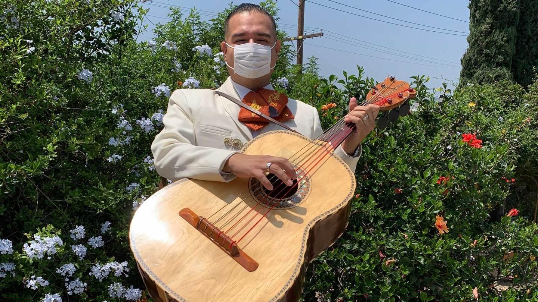 Joel Jacques of Mariachi Los Criollos de Guadalajara holds his guitarrón before a Los Angeles gig.   Courtesy of Joel Jacques