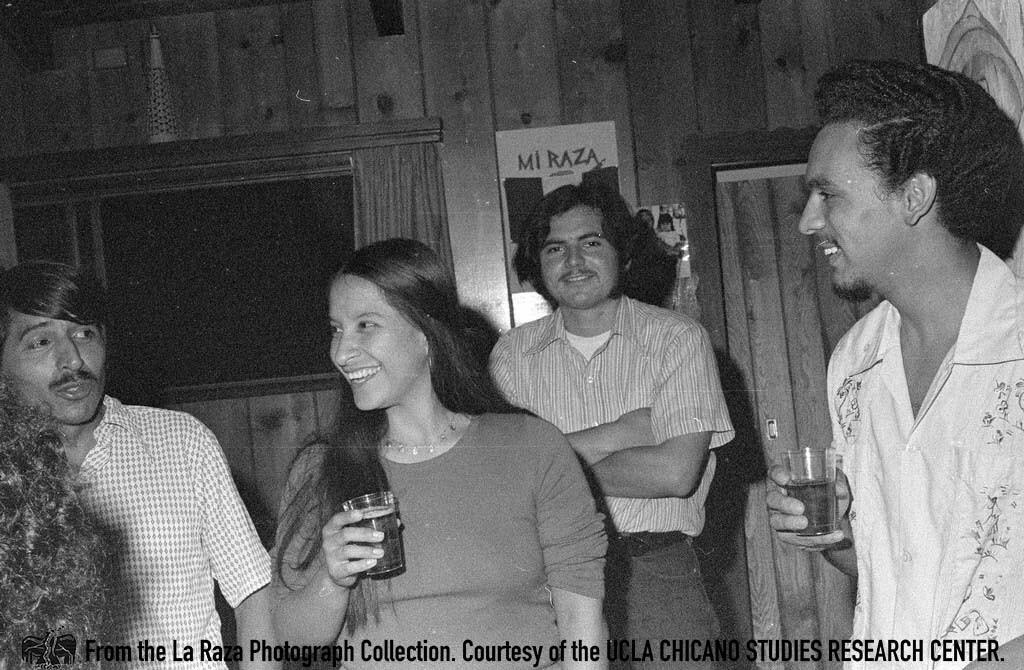 CSRC_LaRaza_B14F5S2_N012 A La Raza staff party including Daniel Zapata and Patricia Borjon   Manuel Barrera, Jr., La Raza photograph collection. Courtesy of UCLA Chicano Studies Research Center
