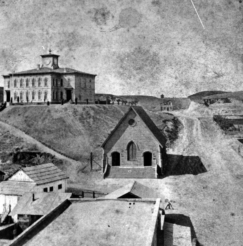 A series of bald, treeless hills separated by gullies once dominated downtown Los Angeles' western horizon. Here, Los Angeles High School towers over its surroundings atop Poundcake Hill. Courtesy of the Photo Collection - Los Angeles Public Library.