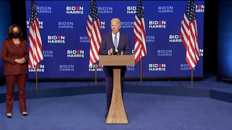 Joe Biden comments on election progress with Kamala Harris off to the side on November 4, 2020.