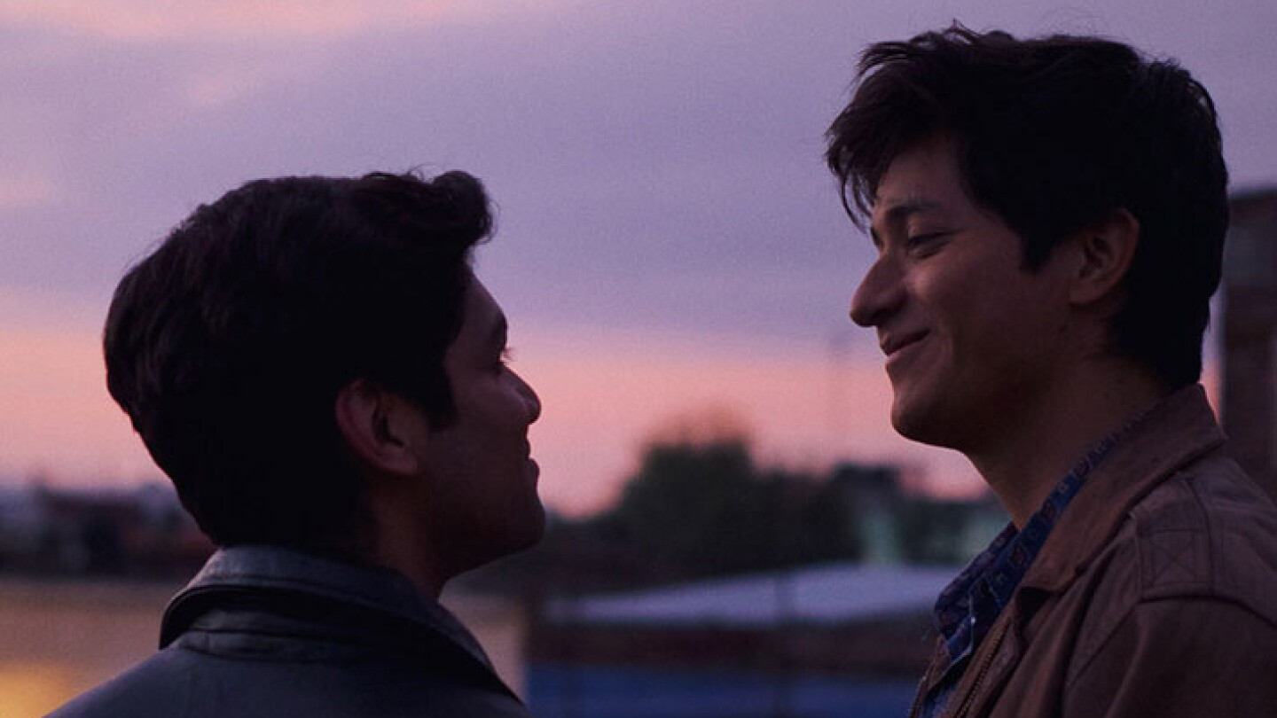 Gerardo and Ivan smile at each other.