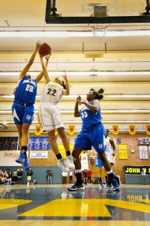 Simone DeCoud reaching for the rebound over 'the bigs'   Photograph by Douglas McCulloh
