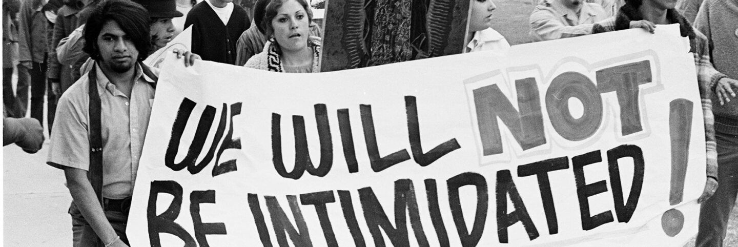 "CSRC_LaRaza_B6F2aC3_OC_010 Protesters with ""We Will Not Be Intimidated"" sign at the Marcha Por La Justicia rally at Belvedere Park 