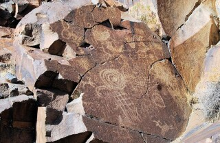Abstract petroglyphs at at Coso Rock Art District National Historic Landmark | Courtesy of Maturango Museum No Trespassing AB s9