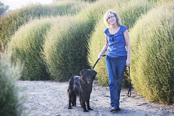 Susan Straight and her dog walks among tumbleweeds along the Santa Ana River in Riverside, CA. | Photo: Douglas McCulloh