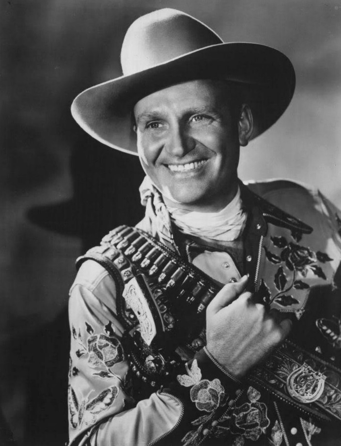 Publicity photo of Gene Autry for his appearance at a banquet to announce a contest for the Seattle Packing Company-Bar-S brand. | Wikimedia Commons/Seattle Packing Company-Bar-S Brand