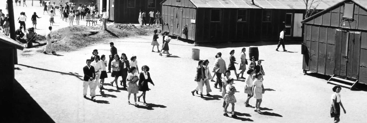 People crossing Manzanar camp | Courtesy of Toyo Miyatake Studio