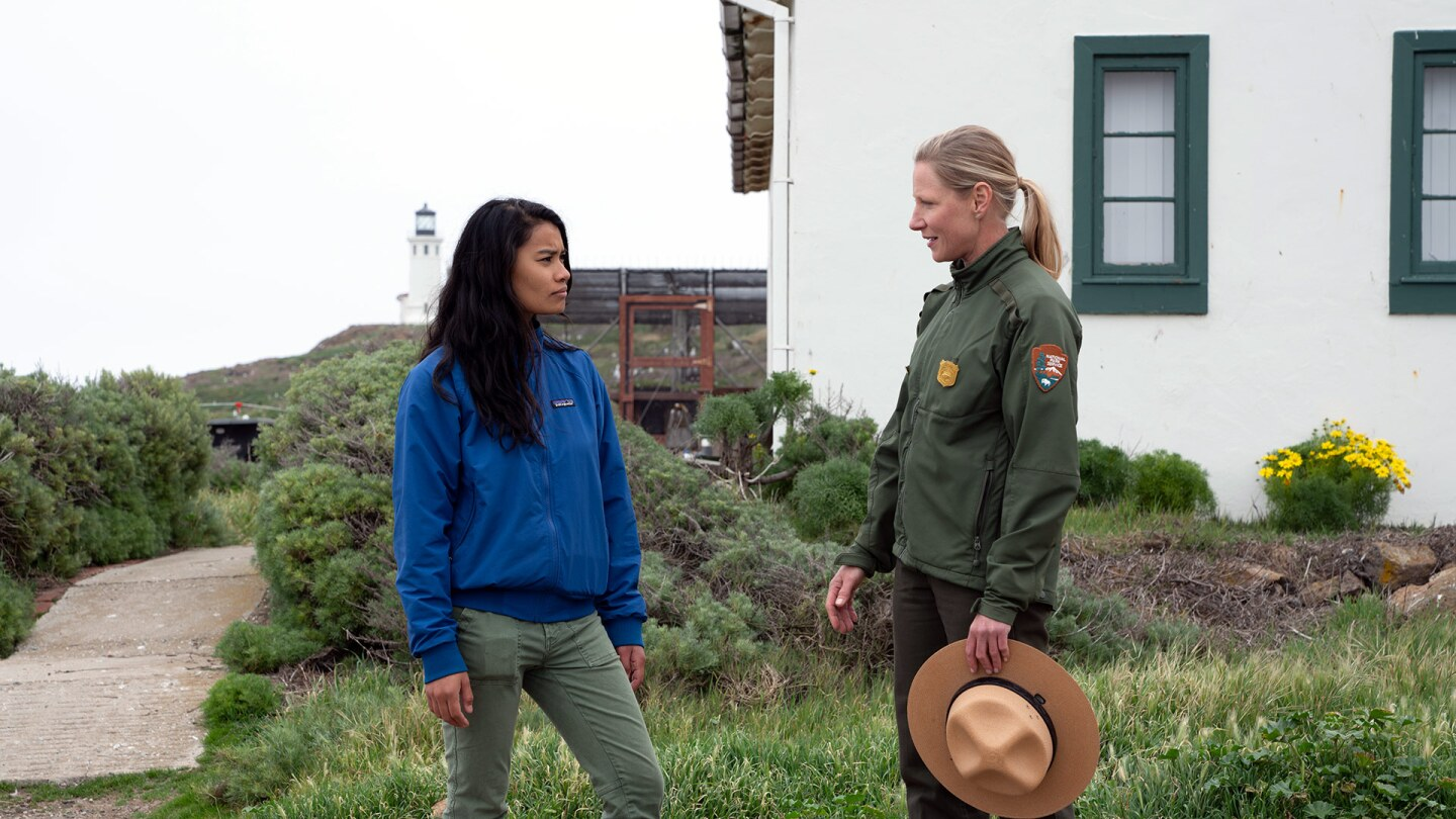 Rosey Alvero and Kelly Moore on Anacapa Island with Lighthouse in Background