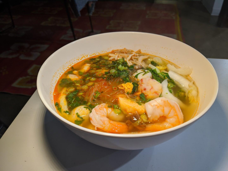 A bowl of sukiyaki, a mung bean noodle soup with shrimp.