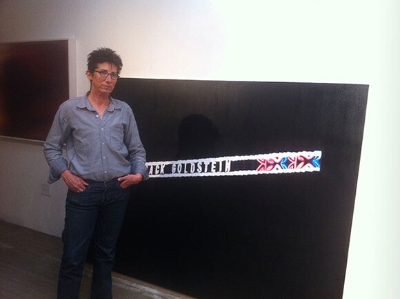 "Susan Silton in her studio with the painting ""John/Jack/David,"" 2012. Photo: Sharon Mizota."