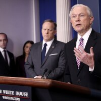 Attorney General Jeff Sessions announced new actions against sanctuary cities that seek Justice Department grants during his surprise appearance at a briefing from White House press secretary Sean Spicer. | Photo by Win McNamee/Getty Images)