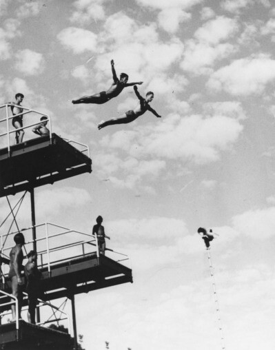 Sammy Lee (left) and Miller Anderson (of Ohio State University) diving off the high platform at the Los Angeles Swimming Stadium in Exposition Park, circa 1948 | Shades of L.A. Collection courtesy of the Los Angeles Public Library