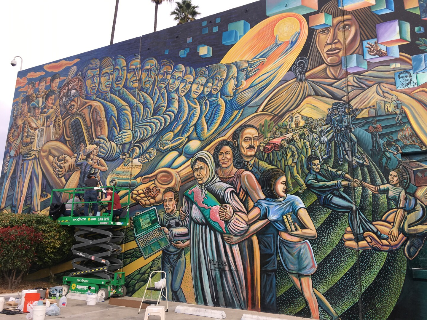 """A 2020 photo of Paul Botello's mural """"The Wall that Speaks, Sings and Shouts"""" at Salazar Park."""