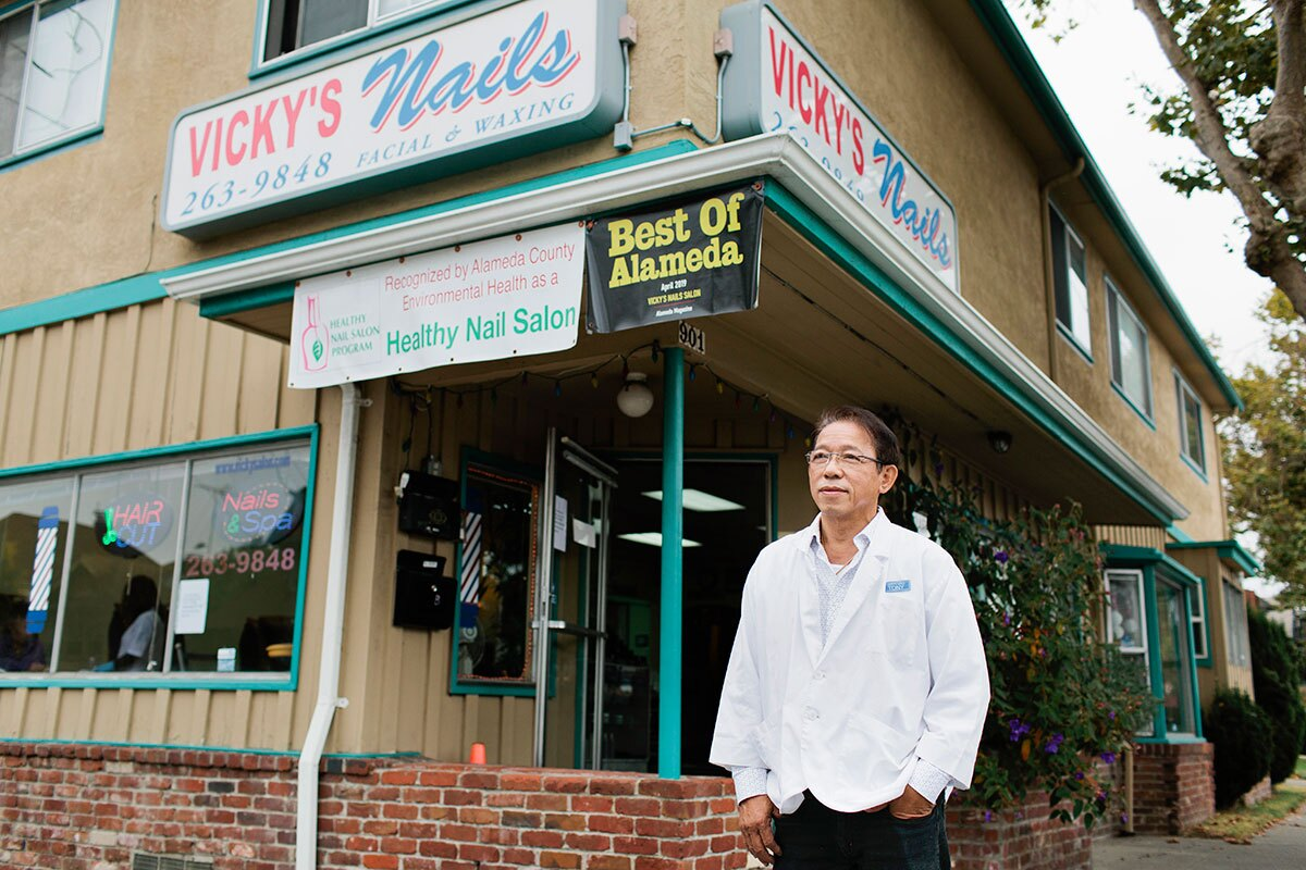 Xuan Huynh, owner of Vicky's Nail Salon, poses for a portrait outside the salon in Alameda, Calif., Wednesday, Aug. 28, 2019. He has owned the salon since 1995. | Alison Yin for KCET