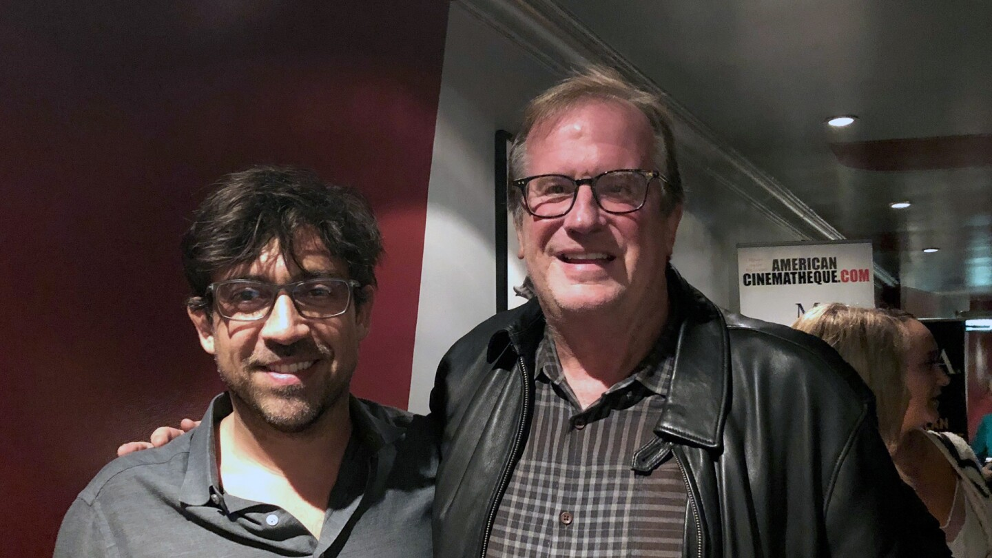 Director Alfonso Gómez-Rejón and KCET Cinema Series host Pete Hammond in the lobby of the Aero Theatre