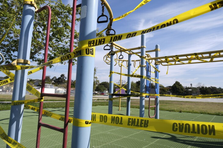 Staff have wrapped a playground structure at Walgrove Avenue Elementary in caution tape.