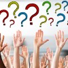 Hands raised in the air with question marks