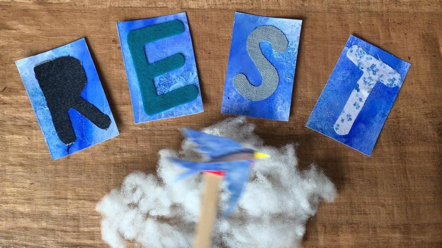 """Handcrafted letters placed on a wooden surface spell out the word """"Rest."""""""