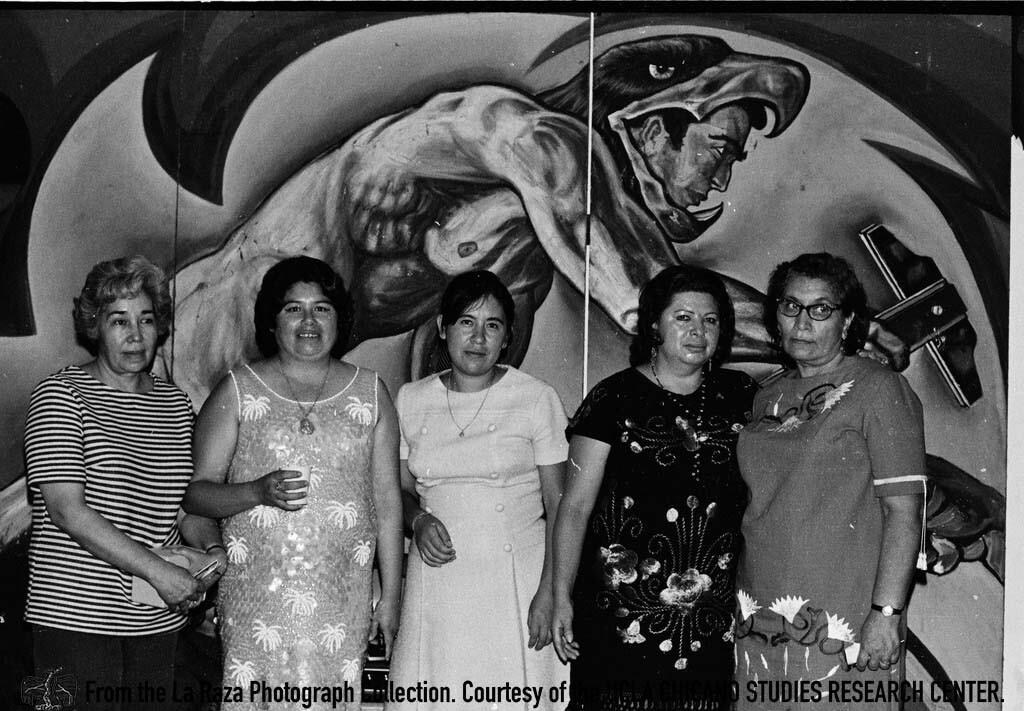 CSRC_LaRaza_B11F13C4_RR_005 Women at a musical performance by Estudiantina de la Facultad de Ingenieria from UNAM | Pedro Arias, La Raza photograph collection. Courtesy of UCLA Chicano Studies Research Center